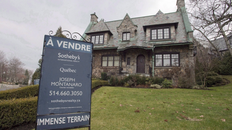 A house for sale in the Westmount suburb of Montreal is shown on December 11, 2015. A new report says luxury real estate sales in Canada's top-tier housing markets headed in opposite directions in the first half of this year, with dwindling sales in Vancouver and gains in Toronto and Montreal. THE CANADIAN PRESS/Ryan Remiorz
