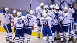 Toronto Maple Leafs players celebrate their victory over the Columbus Blue Jackets in overtime NHL Eastern Conference Stanley Cup playoff action in Toronto on Friday, August 7, 2020. THE CANADIAN PRESS/Frank Gunn