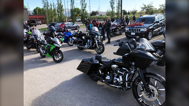 A group of bikers gather Saturday at a Tim Horton's at Deerfoot City before driving to Red Deer. They're part of Against All Abuse, a charity motorcycle group who joined with Bikers Are Buddies to do group ride to support a girl being bullied.