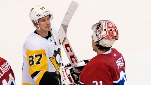 Pittsburgh Penguins centre Sidney Crosby (87) congratulates Montreal Canadiens goaltender Carey Price (31) after the Canadiens defeated the Penguins in NHL Eastern Conference Stanley Cup playoff action in Toronto on Friday, August 7, 2020. THE CANADIAN PRESS/Frank Gunn