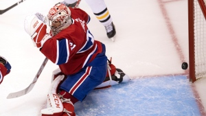 The puck hits the post behind Montreal Canadiens goaltender Carey Price (31) during third period NHL Eastern Conference Stanley Cup playoff action against the Pittsburgh Penguins in Toronto on Friday, August 7, 2020. THE CANADIAN PRESS/Frank Gunn