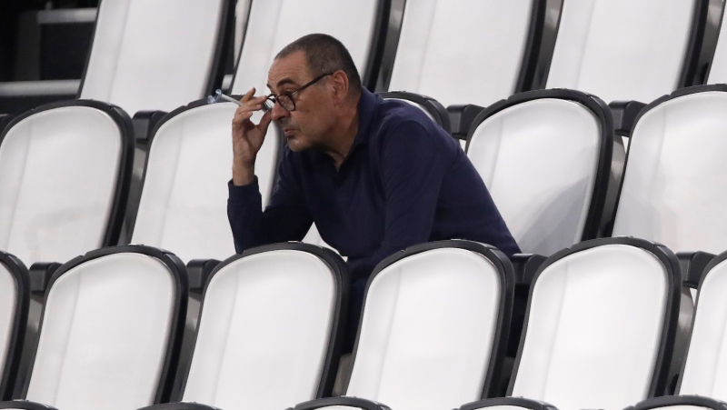In this Saturday, Aug. 1, 2020 filer, Juventus' head coach Maurizio Sarri smokes during a Serie A soccer match between Juventus and Roma, at the Allianz stadium in Turin, Italy. (AP Photo/Luca Bruno, File)
