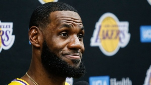 In this Sept. 27, 2019, file photo, Los Angeles Lakers forward LeBron James speaks during the NBA basketball team's media day in El Segundo, Calif. This season's NBA MVP has won the award before. A trio of past winners of the award — reigning MVP Giannis Antetokounmpo of the Milwaukee Bucks, four-time MVP LeBron James of the Los Angeles Lakers and 2017-18 winner James Harden of the Houston Rockets — were announced Saturday, Aug. 8, 2020, as the finalists for this season's top NBA individual honor. (AP Photo/Ringo H.W. Chiu, File)