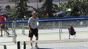 Glenn Stumborg, a board member with Saskatoon Pickleball Inc., plays on an outdoor pickelball court in Saskatoon on Aug. 8, 2020 (Chad Leroux/CTV Saskatoon)