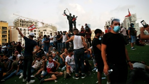 Demonstrators gather at Martyrs Square to protest against the political elites and the government after this week's deadly explosion at Beirut port which devastated large parts of the capital in Beirut, Lebanon, Saturday, Aug. 8, 2020. (AP Photo/Thibault Camus)