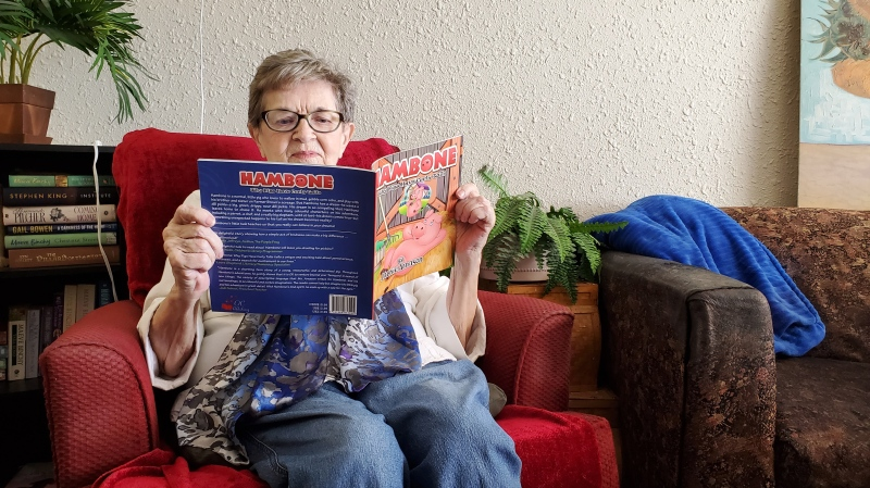 "Jackie Arnason reads her first published children's book ""Hambone: Why Pigs Have Curly Tails."" (Donovan Maess/CTV News)"
