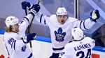 Toronto Maple Leafs' Auston Matthews (34) celebrates his game winning goal against the Columbus Blue Jackets' with teammates William Nylander (88) and Kasperi Kapanen (24) during overtime NHL Eastern Conference Stanley Cup playoff action in Toronto on Friday, August 7, 2020. THE CANADIAN PRESS/Frank Gunn