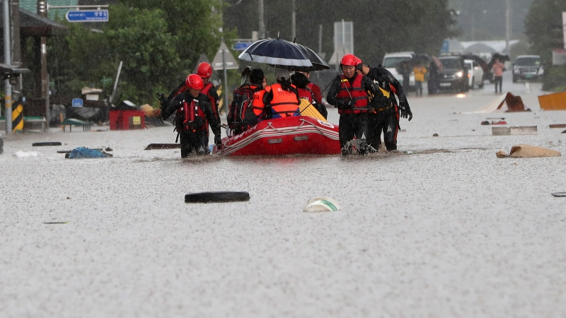 Rescue workers evacuate residents on a rubber boat in Cheorwon, South Korea, Wednesday, Aug. 5, 2020. (Yang Ji-ung/Yonhap via AP)
