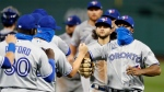Toronto Blue Jays' Teoscar Hernandez, right, and teammates celebrate after defeating the Boston Red Sox during a baseball game, Saturday, Aug. 8, 2020, in Boston. (AP Photo/Michael Dwyer)