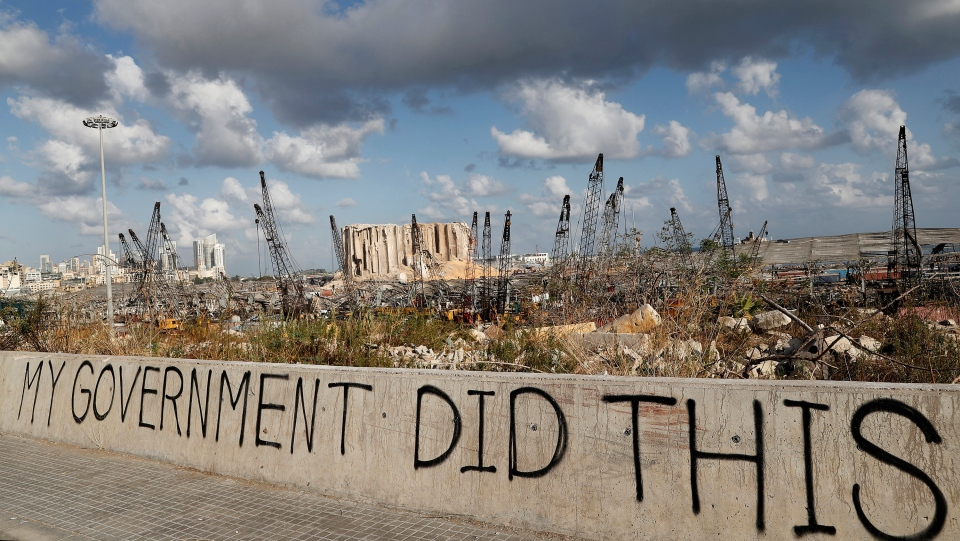 Words are written by Lebanese citizens in front of the scene of Tuesday's explosion that hit the seaport of Beirut, Lebanon, Sunday, Aug. 9, 2020. (AP Photo/Hussein Malla)