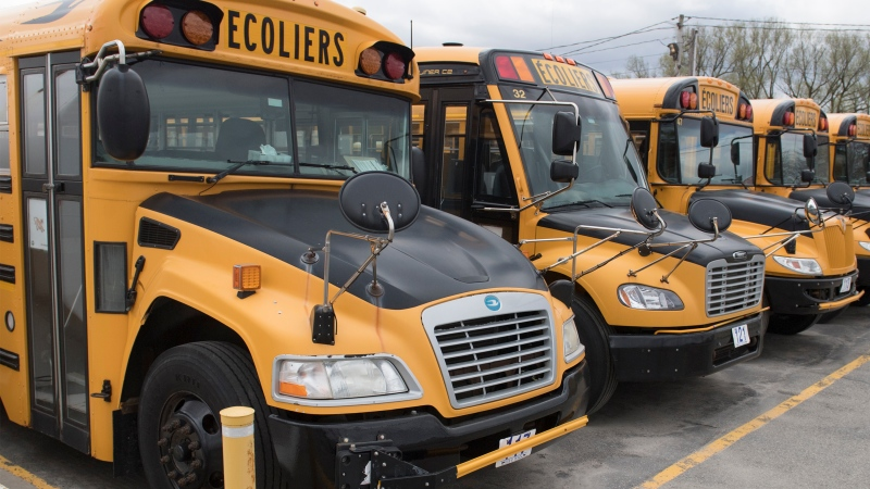 Scores of parents across Quebec are voicing their concerns around the government's intention to get all students from pre-school through Grade 9 to physically return to schools across the province at the end of the month. School buses are shown at a depot in Vaudreuil-Dorion, Que., west of Montreal, Sunday, May 10, 2020. THE CANADIAN PRESS/Graham Hughes