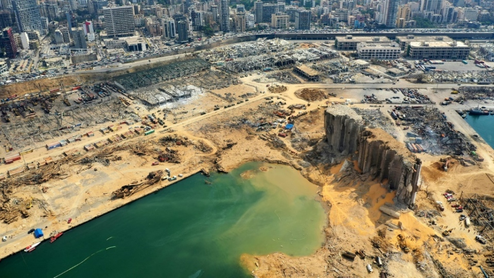 An aerial view of parts of the devastated Beirut port taken on Aug. 7 shows the crater caused by the colossal explosion three days earlier of a huge pile of ammonium nitrate that had languished for years in a port warehouse. (AFP)