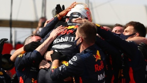Red Bull driver Max Verstappen of the Netherlands celebrates after winning the 70th Anniversary Formula One Grand Prix at the Silverstone circuit, Silverstone, England, Sunday, Aug. 9, 2020. (Bryn Lennon, Pool via AP)