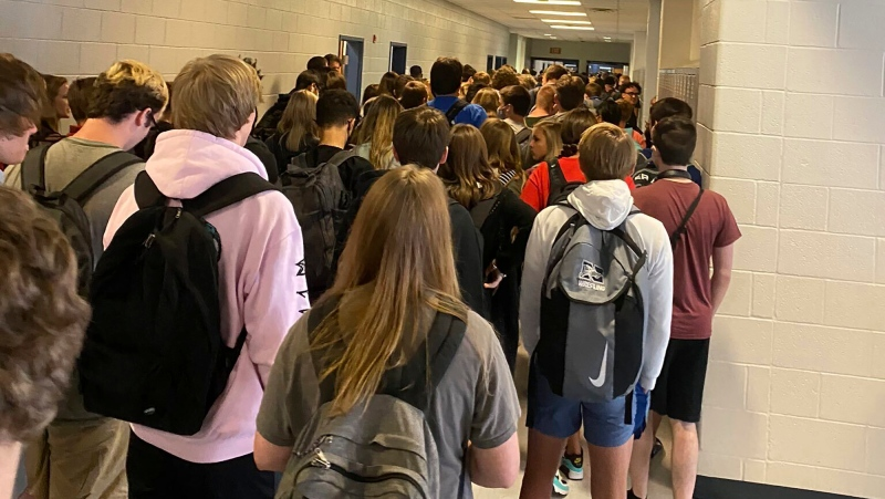In this photo posted on Twitter, students crowd a hallway, Tuesday, Aug. 4, 2020, at North Paulding High School in Dallas, Ga. (Twitter via AP, File)