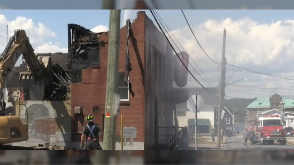 Once crews arrived, the fire had spread to an adjacent building that houses the well-known Vogue Theatre.