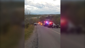 A man is under arrest following a collision between a vehicle and a bicycle Saturday that left one man dead