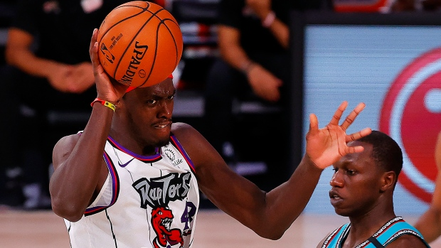 Toronto Raptors' Pascal Siakam, left, is charged with an offensive foul against Memphis Grizzlies' Gorgui Dieng, right, during the second quarter of an NBA basketball game Sunday, Aug. 9, 2020, in Lake Buena Vista, Fla. (Kevin C. Cox/Pool Photo via AP)