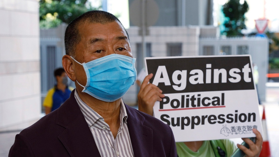 In this July 30, 2020, file photo, Hong Kong media tycoon Jimmy Lai, founder of the local newspaper Apple Daily, arrives a district court in Hong Kong. (AP Photo/Kin Cheung, File)