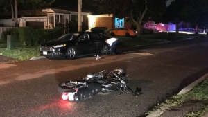 The scene of a collision involving a motorcyclist is pictured on Goldsmith Avenue, near Pharmacy Avenue Sunday August 9, 2020. (Michael Nguyen /CP24)
