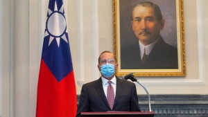 U.S. Health and Human Services Secretary Alex Azar speaks during a meeting with Taiwan's President Tsai Ing-wen, unseen, in front of a portrait of Sun Yat-sen, who is widely regarded as the founding father of modern China, in Taipei, Taiwan, Monday, Aug. 10, 2020. (Central News Agency Pool via AP Photo)