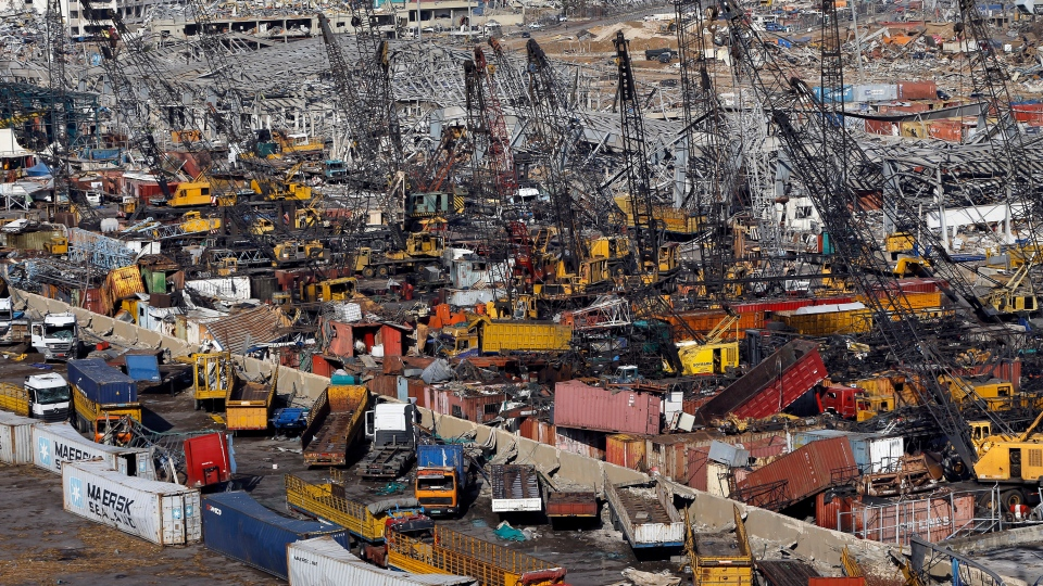 Rows of destroyed trucks are seen at the site of last week's explosion that hit the seaport of Beirut, Lebanon, Monday, Aug. 10, 2020. (AP Photo/Bilal Hussein)