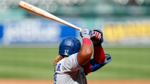 Toronto Blue Jays' Vladimir Guerrero Jr. bats during the sixth inning of a baseball game against the Boston Red Sox, Sunday, Aug. 9, 2020, in Boston. (AP Photo/Michael Dwyer)