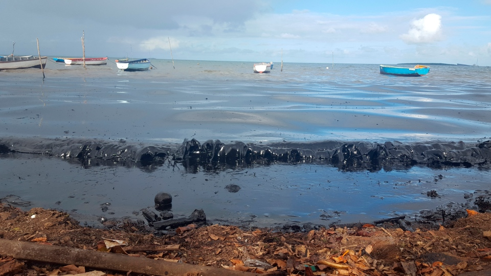This photo taken and provided by Sophie Seneque, shows oil polluting the foreshore of the public beach in Riviere des Creoles, Mauritius, Saturday Aug. 8, 2020, after it leaked from the MV Wakashio, a bulk carrier ship that recently ran aground off the southeast coast of Mauritius. Thousands of students, environmental activists and residents of Mauritius are working around the clock to reduce the damage done to the Indian Ocean island from an oil spill after a ship ran aground on a coral reef. Shipping officials said an estimated 1 ton of oil from the Japanese ship's cargo of 4 tons has escaped into the sea. Workers were trying to stop more oil from leaking, but with high winds and rough seas on Sunday there were reports of new cracks in the ship's hull. (Sophie Seneque via AP)