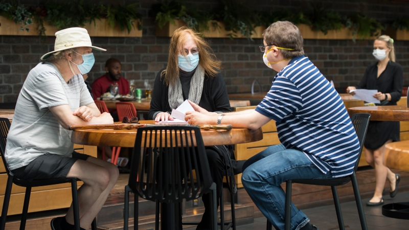Patrons sit on the patio at Joey Sherway, part of the Joey Restaurant chain during the COVID-19 pandemic in Toronto on Wednesday, June 24, 2020. THE CANADIAN PRESS/Nathan Denette