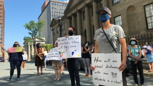 Dozens of people gathered outside the Nova Scotia legislature on Monday, looking for clarification and changes to the province's back-to-school plan. (Natasha Pace/CTV Atlantic)