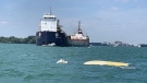 A 13-foot pleasure craft is capsized in the Detroit River on Monday, Aug. 8, 2020. (Courtesy OPP)