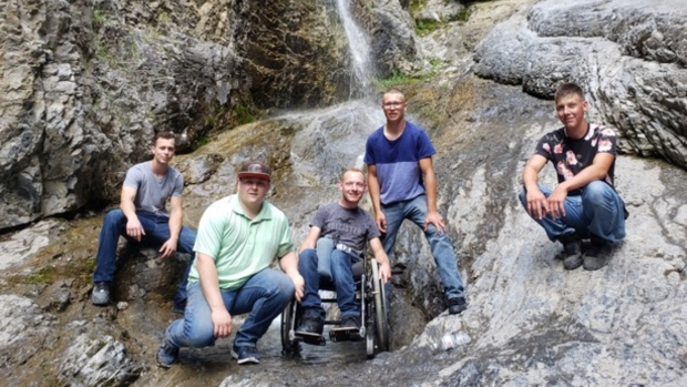 'Aaron goes wherever we go': Friends carry man in wheelchair to view waterfall