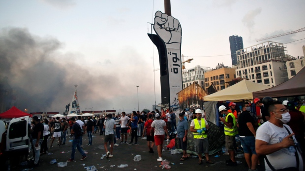 Demonstrators stand as they protest against the political elites and the government after this week's deadly explosion at Beirut port which devastated large parts of the capital in Beirut, Lebanon, Saturday, Aug. 8, 2020. (AP Photo/Thibault Camus)