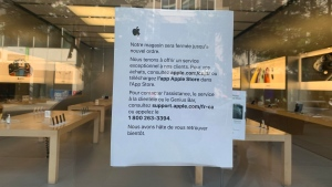 A sign on the front door of the downtown Montreal Apple Store on Aug. 10, 2020 (Photo/Daniel J. Rowe)