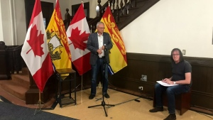 N.B. Premier Blaine Higgs speaks to media at the New Brunswick legislature on Monday, August 10.