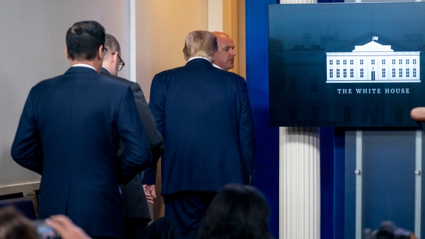 U.S. President Donald Trump is asked to leave the James Brady Press Briefing Room by a member of the U.S. Secret Service during a news conference at the White House, Monday, Aug. 10, 2020. (AP Photo/Andrew Harnik)