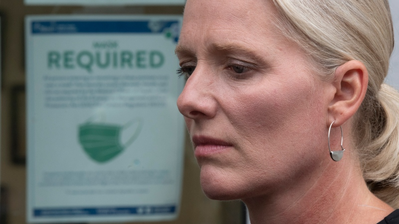 Infrastructure and Communities Minister Catherine McKenna is seen as she speaks with the media outside her constituency office in Ottawa Monday, August 10, 2020. (Adrian Wyld/THE CANADIAN PRESS)