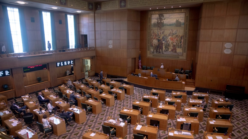 The House works to adopts rules during a special session of the state Legislature at the Capitol in Salem, Ore., Monday, Aug. 10, 2020. (Brian Hayes/Statesman Journal via AP)