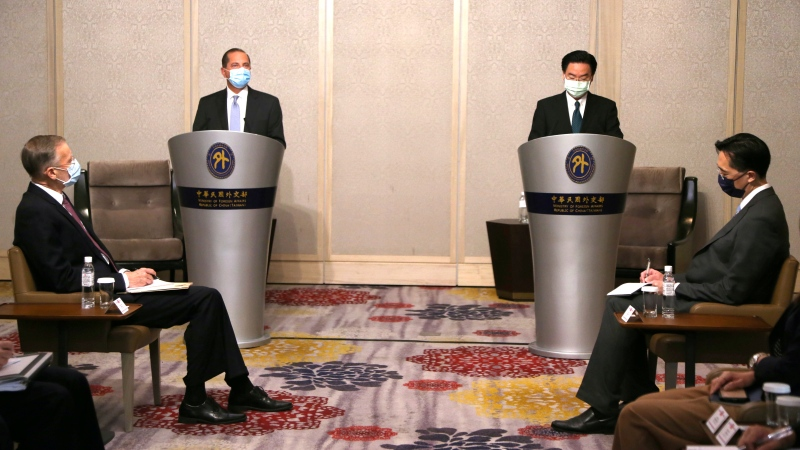 U.S. Health and Human Services Secretary Alex Azar, second from left, speaks at the start of a meeting with Taiwanese Foreign Minister Joseph Wu, standing at right, in Taipei, Taiwan Tuesday, Aug. 11, 2020. (AP Photo/Chiang Ying-ying)