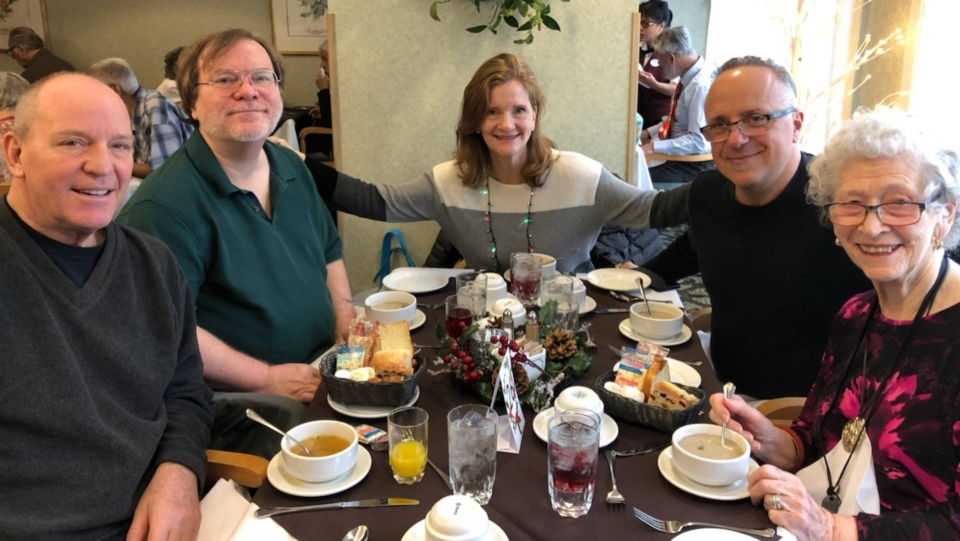 Mary House Goldman, her husband Michael Goldman and her brothers Danny, 63, are seen celebrating Christmas at her mother's nursing home. (Provided by Mary Goldman)