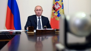 Russian President Vladimir Putin attends a cabinet meeting at the Novo-Ogaryovo residence outside Moscow, Russia, Tuesday, Aug. 11, 2020. Putin says that a coronavirus vaccine developed in the country has been registered for use and one of his daughters has already been inoculated. (Alexei Nikolsky, Sputnik, Kremlin Pool Photo via AP)