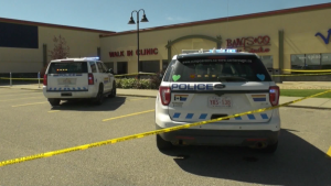 Police cars outside walk-in clinic in Red Deer