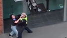 A Melbourne police officer was seen grabbing a woman's neck after approaching her for not wearing a mandatory face mask.