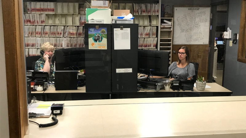 Lisa Teeple (left) and Jena Belleau work inside the Zorra Township Offices on Tuesday, August 11, 2020 (Sean Irvine CTV)
