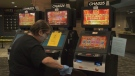 An employee disinfects a slot machine inside of Riverview Gaming Centre in Chatham, Ont. (Michelle Maluske/CTV Windsor)