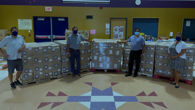Wiikwemkoong receives kits of food and safety supplies from Hydro One and GlobalMedic. Left to right: Scott Flamand, Community Food Distribution Coordinator; Ogimaa Duke Peltier; Kevin Wassegijig, Director of Operations; Shelley Trudeau, Ontario Works Administrator/ Community Food Security Team Lead