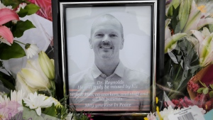 An impromptu memorial for Dr. Walter Reynolds, who died after he was attacked in an examination room rests outside the Village Mall walk-in clinic in Red Deer, Alta., Tuesday, Aug. 11, 2020.THE CANADIAN PRESS/Jeff McIntosh