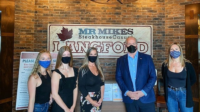 B.C. Premier John Horgan visited a Vancouver Island restaurant after staff members were reportedly berated for trying to seat a large group of people at different tables: (Mr. Mike's / Facebook)