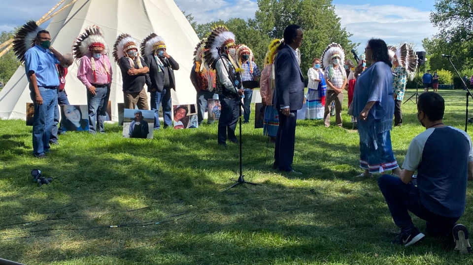 Chiefs from the Federation of Sovereign Indigenous Nations meet with Tristen Durocher at the Walking with our Angels site on the legislature grounds. (CTV Regina)