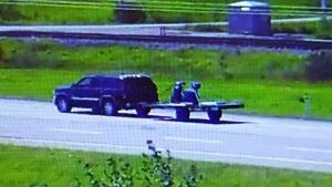 RCMP are seeking a GMC Yukon SUV, 2000-2006 black or dark blue model, involved in a fatal hit-and-run. (Supplied:RCMP)