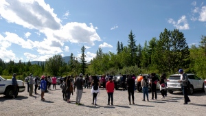 Volunteers from Redeemed Christian Church of God gather to pray for the well being of Blessing Paul on Tuesday after spending the day searching the banks of the Bow River and Seebee Lake.